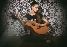 Sad pretty girl with guitar Stock Photos