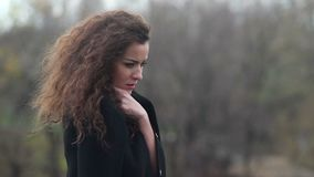 Sad pretty lady freezing outside, cold autumn wind, loneliness. Stock footage stock footage