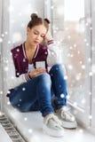 Sad pretty teenage girl with smartphone texting Royalty Free Stock Photo