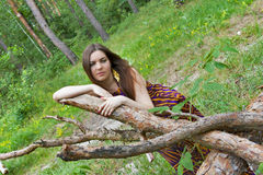 Sad pretty woman lying on the logs Stock Photography