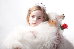 Sad princess with white dog Royalty Free Stock Photography