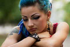 Sad punk girl posing outdoors Royalty Free Stock Images