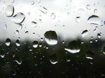 Sad rain drops on the window in black and white Stock Image