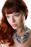 Sad red haired girl close-up. Sad red haired girl and a pearl necklace close-up Stock Images
