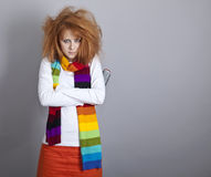 Sad red-haired girl with comb. Royalty Free Stock Photo
