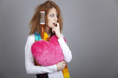 Sad red-haired girl with comb. Stock Image