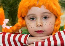 Sad red-haired Little Girl. Sad Red-Haired Girl with Upward Braids Royalty Free Stock Photos