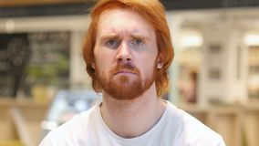 Sad redhead beard man feeling upset and thinking about problems. 4k, high quality stock footage