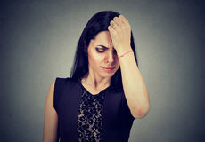 Sad regretful woman looking down royalty free stock images