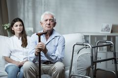 Sad in the retirement house. Elder men is very sad in the retirement home stock image