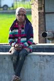 SAD RURAL GIRL SITTING ON A TUBE WELL AFTER WORKING AS CHILD LABOUR Stock Photos