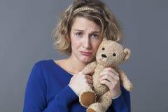 Sad 20s girl cuddling loving comforter to find love Stock Images