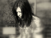 Sad sad girl. Sad teenage girl black and white blur background royalty free stock image