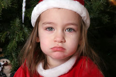 Sad Santa Baby #1. 2 year old, cying in Sana suite Royalty Free Stock Photo