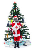 Sad santa with gas mask - environmental concept. With plastic waste on christmas Royalty Free Stock Images
