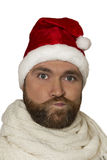 Sad Santa. isolated portrait of upset man wearing santa hat on white background Royalty Free Stock Photo