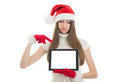 Sad Santa teenage girl pointing at tablet computer Stock Photo