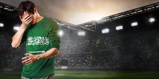 Sad Saudi Arabia player Royalty Free Stock Photo