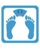 Sad scales. Scales with a sad expression and foot prints Stock Image