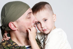 Sad scene farewell. Of the son to father leaving on military service stock images