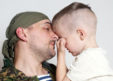 Sad scene farewell. Of the son to father leaving on military service stock photo