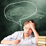 Sad school boy Stock Images