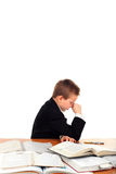 Sad schoolboy. Very sad schoolboy crying on the table isolated on the white background Stock Photo