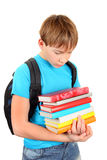 Sad Schoolboy with a Books Royalty Free Stock Photos