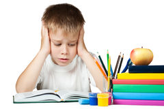 Sad schoolboy doing is homework Stock Image