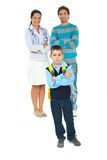 Sad schoolboy in front of parents royalty free stock image