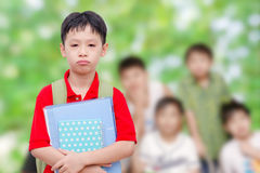 Sad schoolboy at school. Sad asian schoolboy at school royalty free stock photography