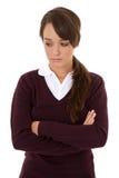 Sad schoolgirl. Portrait of an unhappy looking schoolgirl isolated on white Royalty Free Stock Image