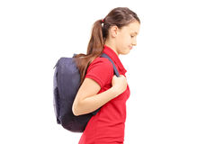 Sad schoolgirl with a bag walking Royalty Free Stock Photos