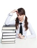 Sad schoolgirl with books Royalty Free Stock Photo