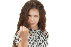 Sad schoolgirl threatening fist Stock Images
