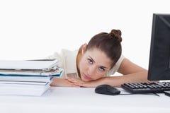 Sad secretary leaning on her desk Stock Photo