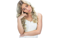 Sad seductive model in white dress posing Stock Photography