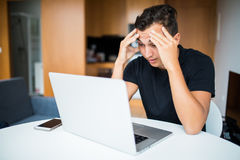 Sad Self employed businessman working from home on laptop Royalty Free Stock Photo