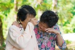 Sad senior Asian women Stock Image