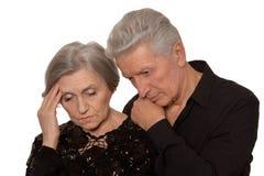 Sad Senior couple. Isolated on white background stock images