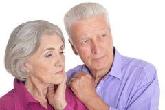 Sad senior couple isolated on white background stock images