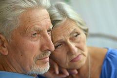 Sad Senior couple. Portrait of a sad senior couple at home stock photos