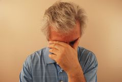 Sad Senior Man. Tired and discouraged aging man Royalty Free Stock Photography