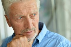 Free Sad Senior Man At Home Stock Photography - 56896422