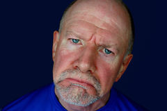 Sad Senior Man with Blue Eyes. A sad, frowning man with blue eyes and ruddy complexion Royalty Free Stock Photography