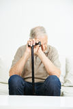Sad senior man with cane Royalty Free Stock Photography