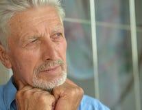 Sad senior man at home Stock Image