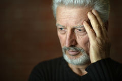 Sad senior man at home Stock Photo