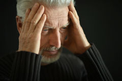 Sad senior man at home Royalty Free Stock Image
