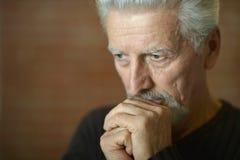 Sad senior man at home Stock Images